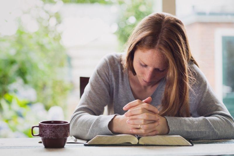 woman praying during morning devotion